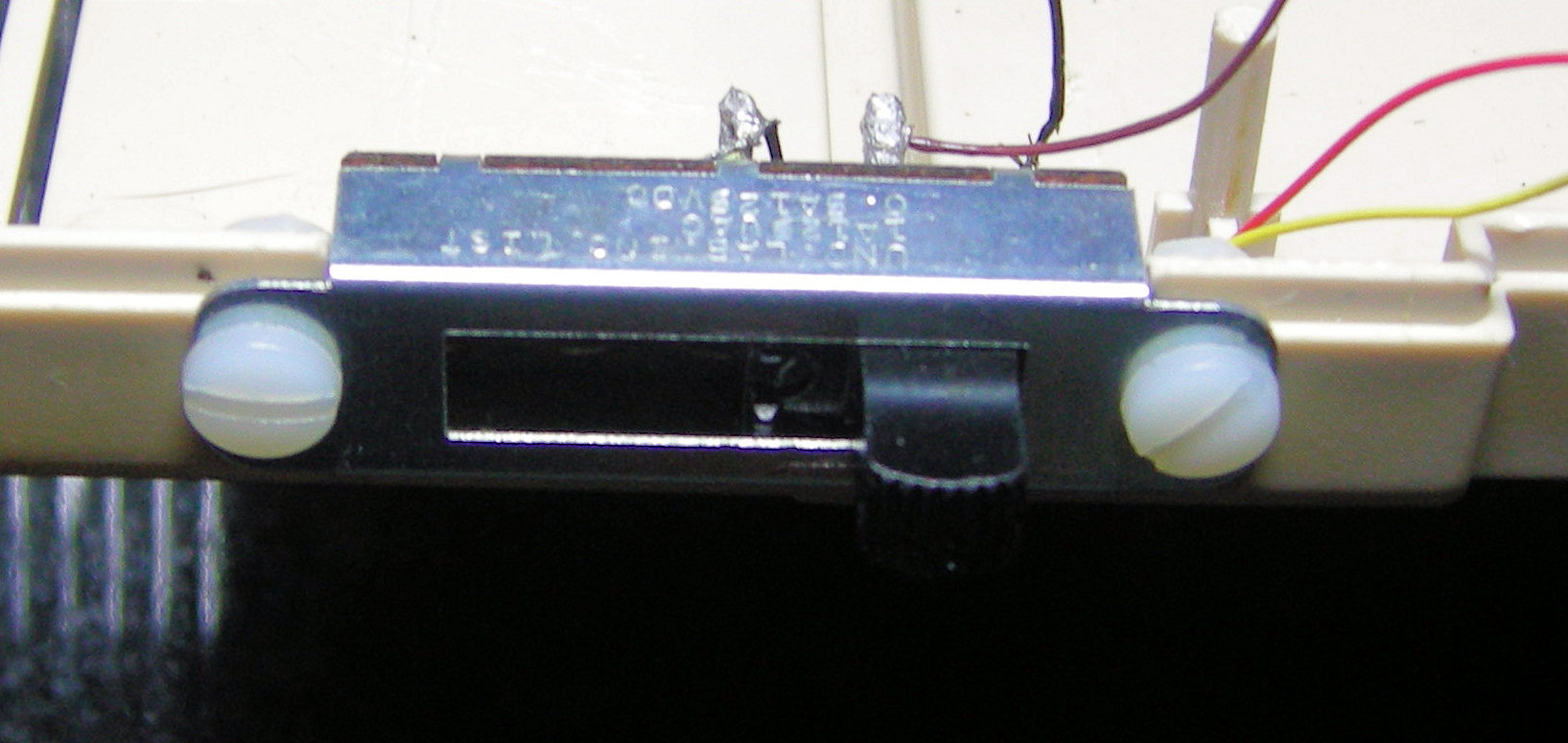 Outside view, showing switch mounting position and screws